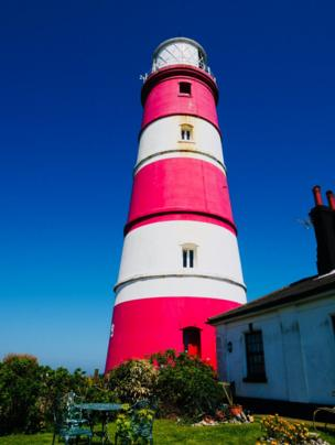 A red and white striped lighthouse