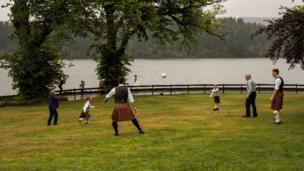 Football game played by wedding guests