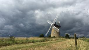 Great Haseley Windmill with storm clouds behind