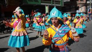 Dancers parade during the festival of Señor del Gran Poder