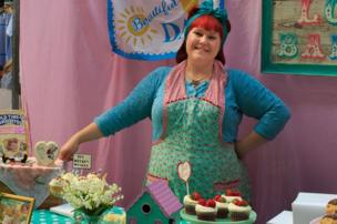 Woman on her cake stall