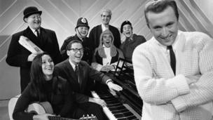Corbett was spotted by David Frost, who recruited him for his satirical sketch show The Frost Report in 1966, where he worked alongside (back row l-r) Nicholas Smith, Ronnie Barker, John Cleese , Nicky Henson, (front row, l-r )Julie Felix,, Tom Lehhrer, Ronnie Corbett and David Frost