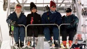 The Prince of Wales with Prince Harry, joined in a ski lift by (left to right) Santa with her sister, Tara Palmer-Tomkinson, on the way up the Gotschnabahn ski runs above Klosters, Switzerland, 1997