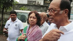 Razaul Karim, right, and Hosne Ara Karim, center, whose son and daughter-in-law were rescued from the restaurant attacked by heavily armed militants, wait for them in Dhaka, Bangladesh, Saturday, 2 July 2016.