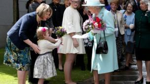 queen receiving flowers