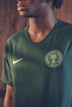 Model wey wear Super Eagles green jersey