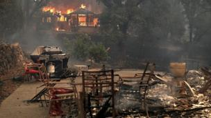 Fire consumes a home as out of control wildfires move through the area on October 9, 2017 in Glen Ellen, California