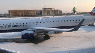 A smattering of snow on the runway at City Airport had caused eight flight cancellations by 9:00 GMT
