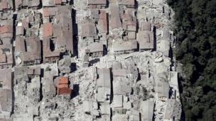 This aerial photo shows the damaged buildings in the town of Amatrice, central Italy, after an earthquake, Wednesday, Aug. 24, 2016