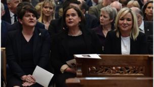 DUP leader, Arlene Foster, seated alongside leader of Sinn Féin, Mary Lou McDonald, and Sinn Féin Vice-President, Michelle O'Neill in St. Anne's Cathedral