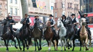 Cowboys on horses at the Magnificent Seven premiere
