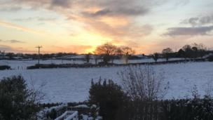 A golden sky provides the backdrop to this winter wonderland in Drumbo, County Down