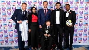 Gareth Southgate (centre back), Jermaine Defoe (right), and Jamie Vardy present Moin Younis the Child/Teenager of Courage award