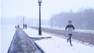 A man running in the snow at Stormont