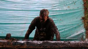 Man covered in mud