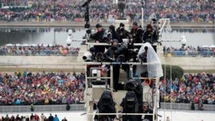 The media prepares for Trump's inauguration ceremony in the rain