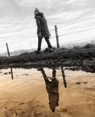 in_pictures Woman passing a puddle