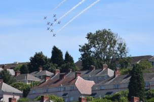 The Red Arrows over houses in Swansea
