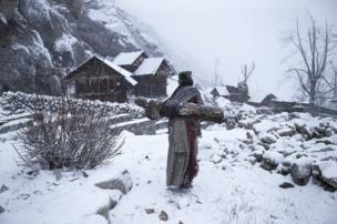 A women carries wood in Shimla, Himachal Pradesh, India.