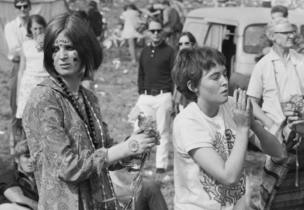 Two young women wearing jewellery and face paint at a Festival of Flower Children held in Woburn Park, seat of the Duke of Bedford.