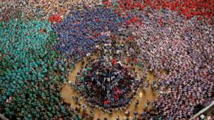 "Capgrossos de Matato form a human tower called ""castell"" during a biannual competition in Tarragona city, Spain, October 2, 2016."