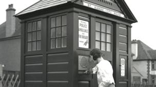 Woman at a police box around 1935