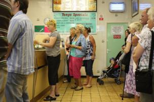 Lunchtime rush at a typical British chippy