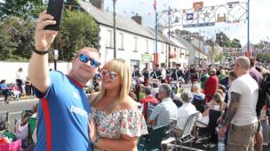 A couple take a selfie as they watch the Twelfth of July parade in Richhill, Armagh, 2017