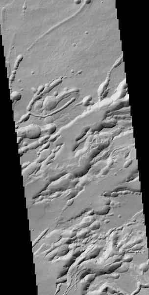 A structure called Arsia Chasmata on the flanks of one of the large volcanoes, Arsia Mons. The width of the image is around 25 km