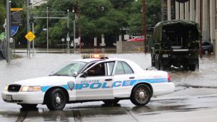 Image shows a Houston Police vehicle in flood waters.