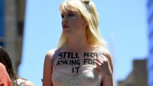 "Woman in underwear with ""Still not asking for it"" written on her chest in Sydney - 21 January 2017"