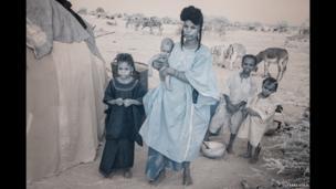 Nomadic community members at a camp