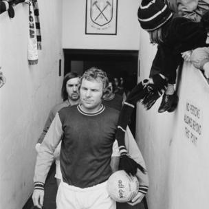 Bobby Moore leading his team out before his last match at the ground,, on 9 March 1974