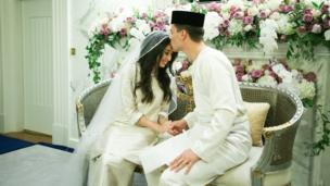 Dennis Muhammad kisses the forehead of his wife Johor Princess Tunku Tun Aminah