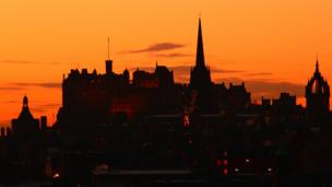 The skyline of Edinburgh against an evening sky