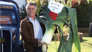 Man holding giant Leek