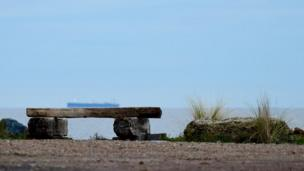 A bench in front of the sea