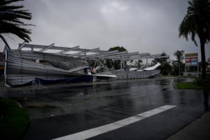 The crumbled canopy of a petrol station damaged by Hurricane Irma is seen in Bonita Springs, Florida, 10 September