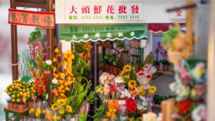 A corner of the Flower Market depicted in the miniature artpiece