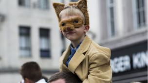 A fan watches the action dressed as a fox