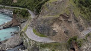 A landslide covers a section of state highway 1 near Kaikoura, New Zealand, Monday, Nov. 14, 2016, after a powerful earthquake