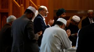 Muslim men pray for victims of the attack at Manchester Arena at a mosque in Manchester, Britain