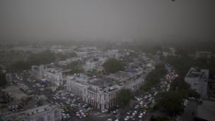 Cloud and sand envelop the skyline during a storm in New Delhi, India, Monday, May 23, 2016.