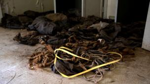 Webbing, belts, pouches and packs strewn on the floor