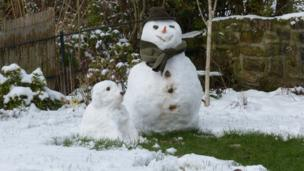 Snowman and a snow dog