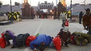 7. Indian fishermen released by Pakistani authorities kiss the ground after crossing the India-Pakistan Wagah border, some 35kms west of Amritsar on January 8, 2018. Pakistan on January 7 released at least 147 Indian fishermen, held for trespassing into its territorial waters, from Karachi's Malir Jail as a goodwill gesture