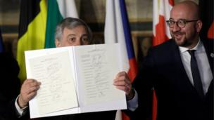 European Parliament President Antonio Tajani, left, holds up the Rome declaration, signed by EU leaders, during an EU summit meeting at the Orazi and Curiazi Hall in the Palazzo dei Conservatori in Rome on Saturday, March 25, 2017