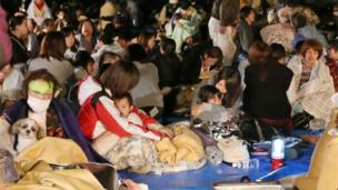 Residents take shelter at the town hall of Mashiki, in Kumamoto, southern Japan, after the earthquake early Friday, April 15, 2016.