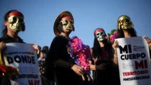Activists take part in a march to protest violence against women and the murder of a 16-year-old girl in a coastal town of Argentina last week, at Revolucion monument, in Mexico City, Mexico, October 19, 2016