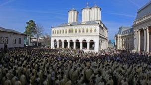 Priests wearing ceremonial outfits attend a pilgrimage ahead of Orthodox Palm Sunday in Bucharest, Romania, 31 March 2018.